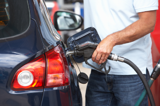 Male Motorist Filling Car With Diesel At Petrol Station